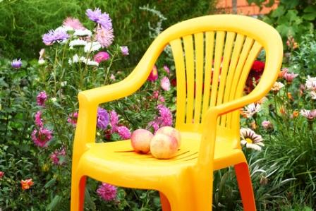 Colorful Yellow Chair used as a garden focal point