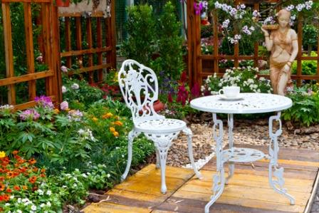 bistro set used as a garden focal point in a patio garden