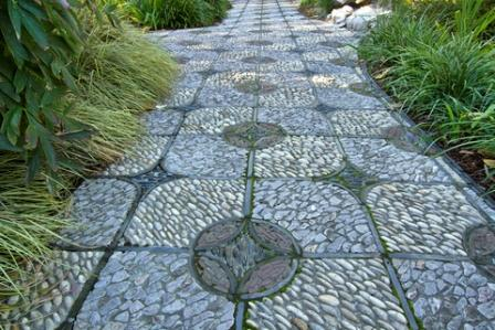 garden mosaic inlaid in a garden path