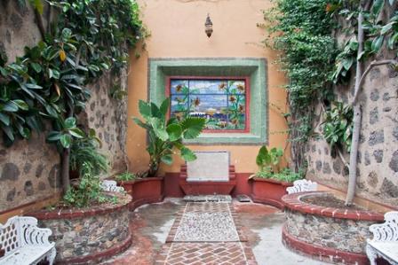 garden mosaic creates a lovely courtyard