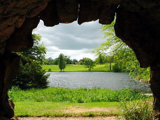 Grotto with view of Bowood House Gardens