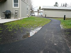 sloping the ground away from the house can improve garden drainage
