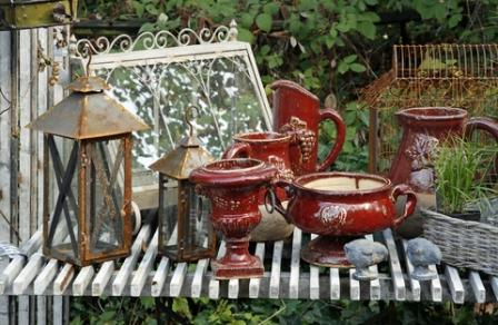 decorative garden accents grouped to create a garden focal point
