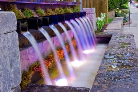 colorful garden water fountain as a focal point