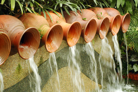 Clay Jars used in an incredible garden water feature