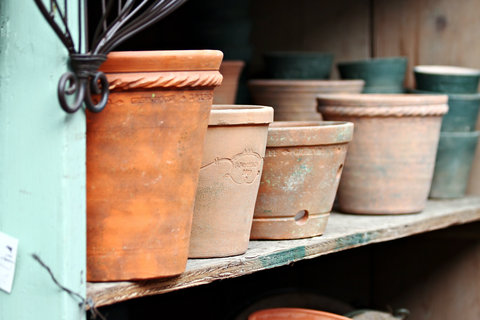 Terra Cotta Pots on a Wooden Shelf