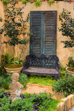 Use an old window shutter as a garden decoratio