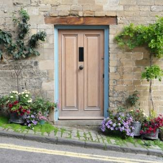 approximate symmetry brings charm to a street entrance